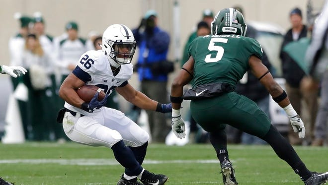 Penn State running back Saquon Barkley runs during the first half of an NCAA college football game against Michigan State, Saturday, Nov. 4, 2017, in East Lansing, Mich. (AP Photo/Carlos Osorio)