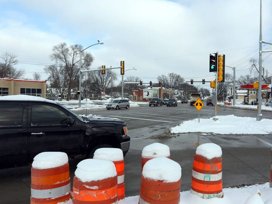 Cars make their way through the intersection of Whiterock