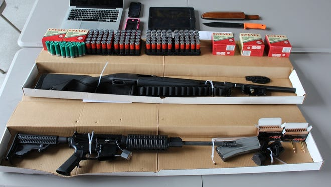 Detectives recovered one 12-gauge Remington shotgun, one DPM5 Model AR-15 rifle, several hundred rounds of ammunition, and a hunting knife, upon execution of the warrant.