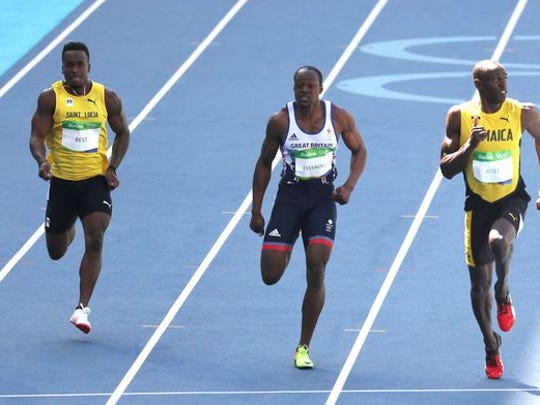 Left to right: Jahvid Best of S. Lucia, Britain's James Dasaolu and Jamaica's Usain Bolt.