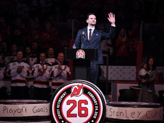 Patrik Elias waves to the crowd during his jersey retirement