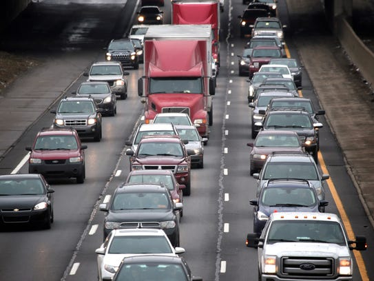 Traffic is seen on I-75 southbound from a pedestrian