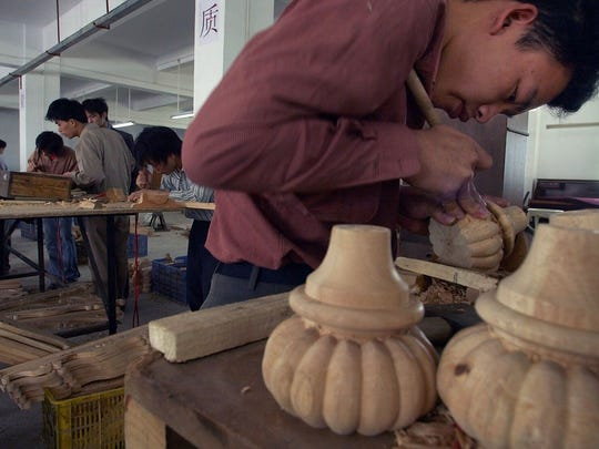 Wei Yuan Yang, 22, hand-carves wooden furniture parts