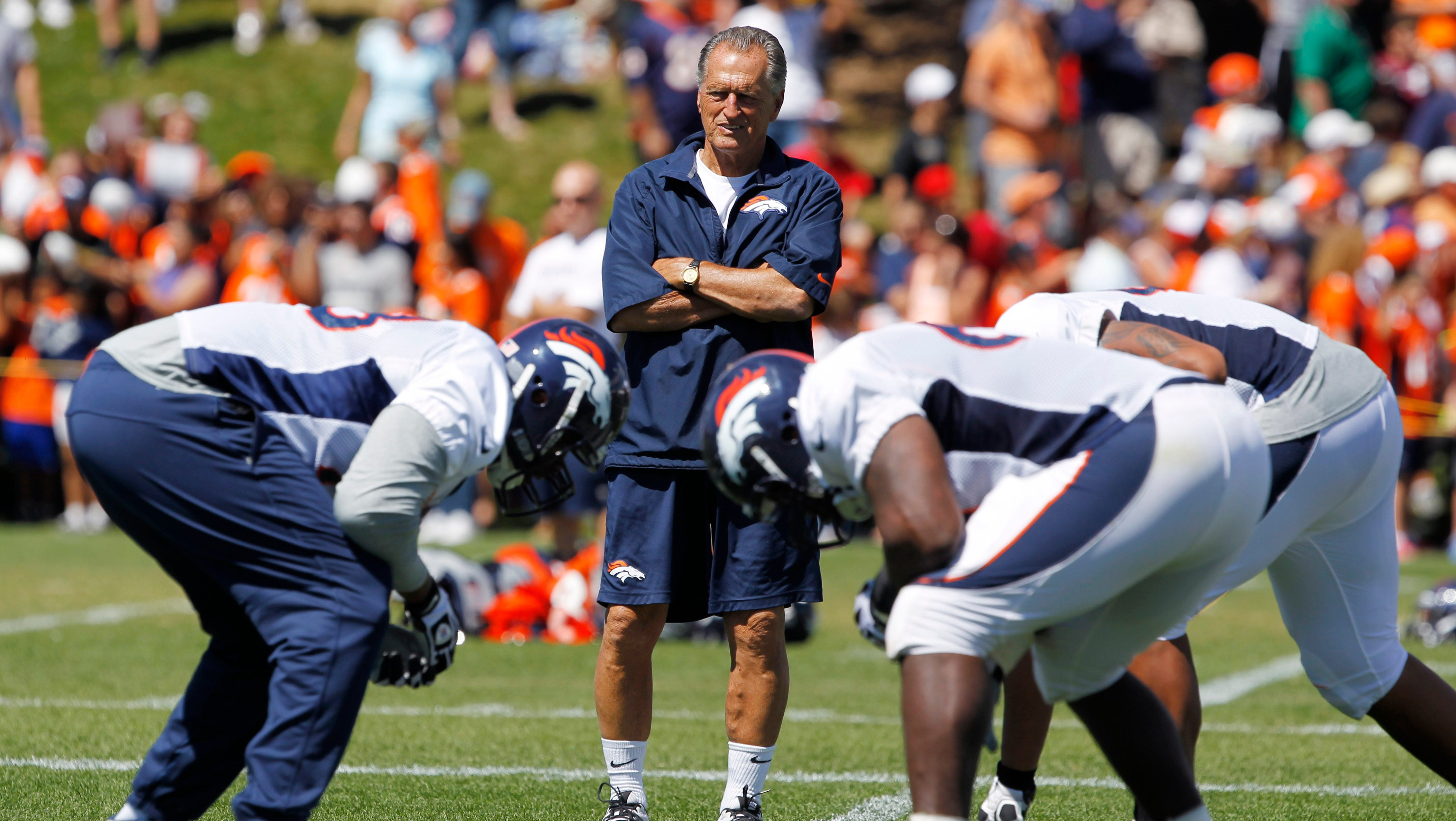 Denver Broncos offensive line consultant Alex Gibbs looks on as linemen take part in drills after the morning session at the team's training camp.