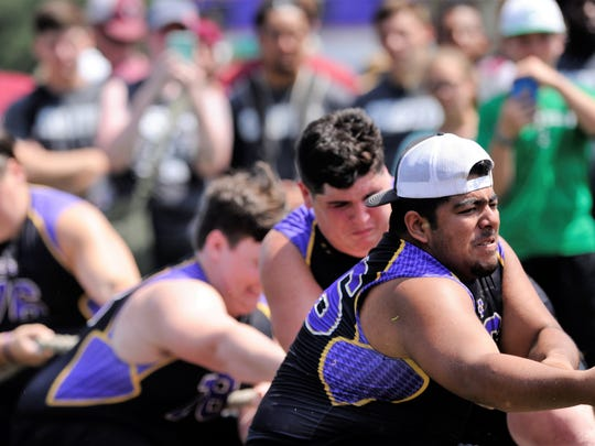 Merkel, led by C.J. Ugalde in the front, competes during the Division II tug of war during the State LineMAN Challenge at Hardin-Simmons University's Shelton Stadium on Saturday. The Badgers won the event and were sixth in the overall standings.