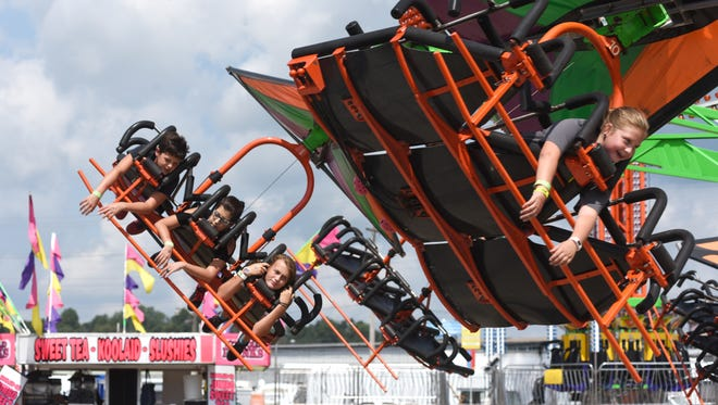 Attendees enjoy the rides this week at the Muskingum County Fair.