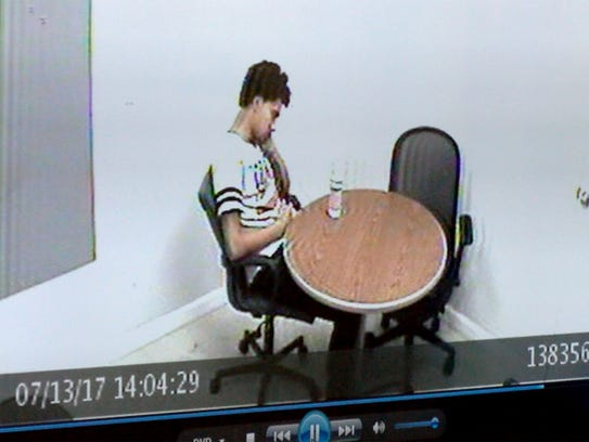 Andreas Erazo is shown in a video as he waits for detectives