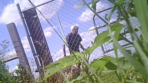 Jeffrey Weigle is pictured in this still from a security video moments before Dean Keller shot him. The neighbors had been arguing since at least 2009.