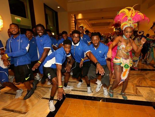 MTSU football players dance down the halls of the Atlantis