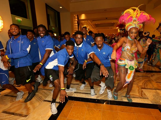 MTSU football players dance down the halls of the Atlantis Paradise Island resort with one of the Junkanoo dancers on Sunday in Nassau, Bahamas.