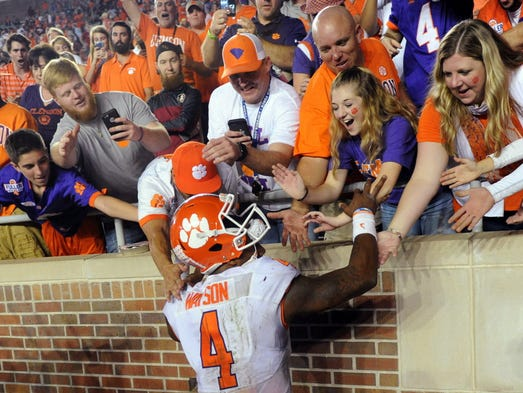 Clemson quarterback Deshaun Watson (4) celebrates after
