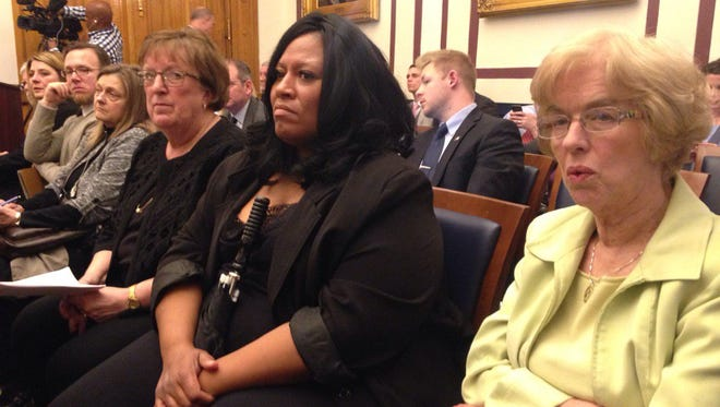Rep. Sue Errington and (right to left) Muncie school board members Kat Carey, Debbie Feick, Bev Kelley and Jason Donati sit on the front row of the Indiana House Ways and Means Committee hearing Monday.