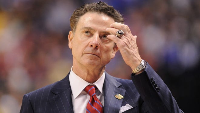 Louisville Cardinals head coach Rick Pitino reacts against the Michigan Wolverines during the second half in the second round of the 2017 NCAA Tournament at Bankers Life Fieldhouse.