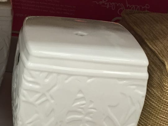 The Lilly Pulitzer for Target embossed stoneware stool in white is priced at $80.