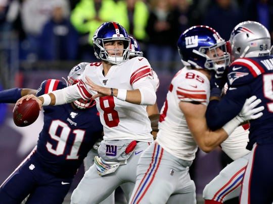 Oct 10, 2019; Foxborough, MA, USA; New York Giants quarterback Daniel Jones (8) looks downfield to the pass the ball against the New England Patriots during the first half at Gillette Stadium. Mandatory Credit: Paul Rutherford-USA TODAY Sports