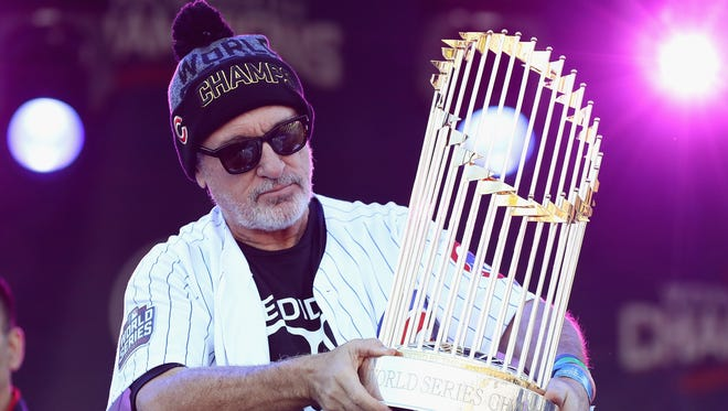 Manager Joe Maddon of the Chicago Cubs holds the World Series trophy during the Chicago Cubs victory celebration in Grant Park on November 4, 2016 in Chicago, Illinois. The Cubs won their first World Series championship in 108 years after defeating the Cleveland Indians 8-7 in Game 7.