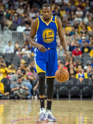 Golden State Warriors forward Kevin Durant (35) moves with the ball against the Los Angeles Lakers during the first quarter of a preseason game at T-Mobile Arena.