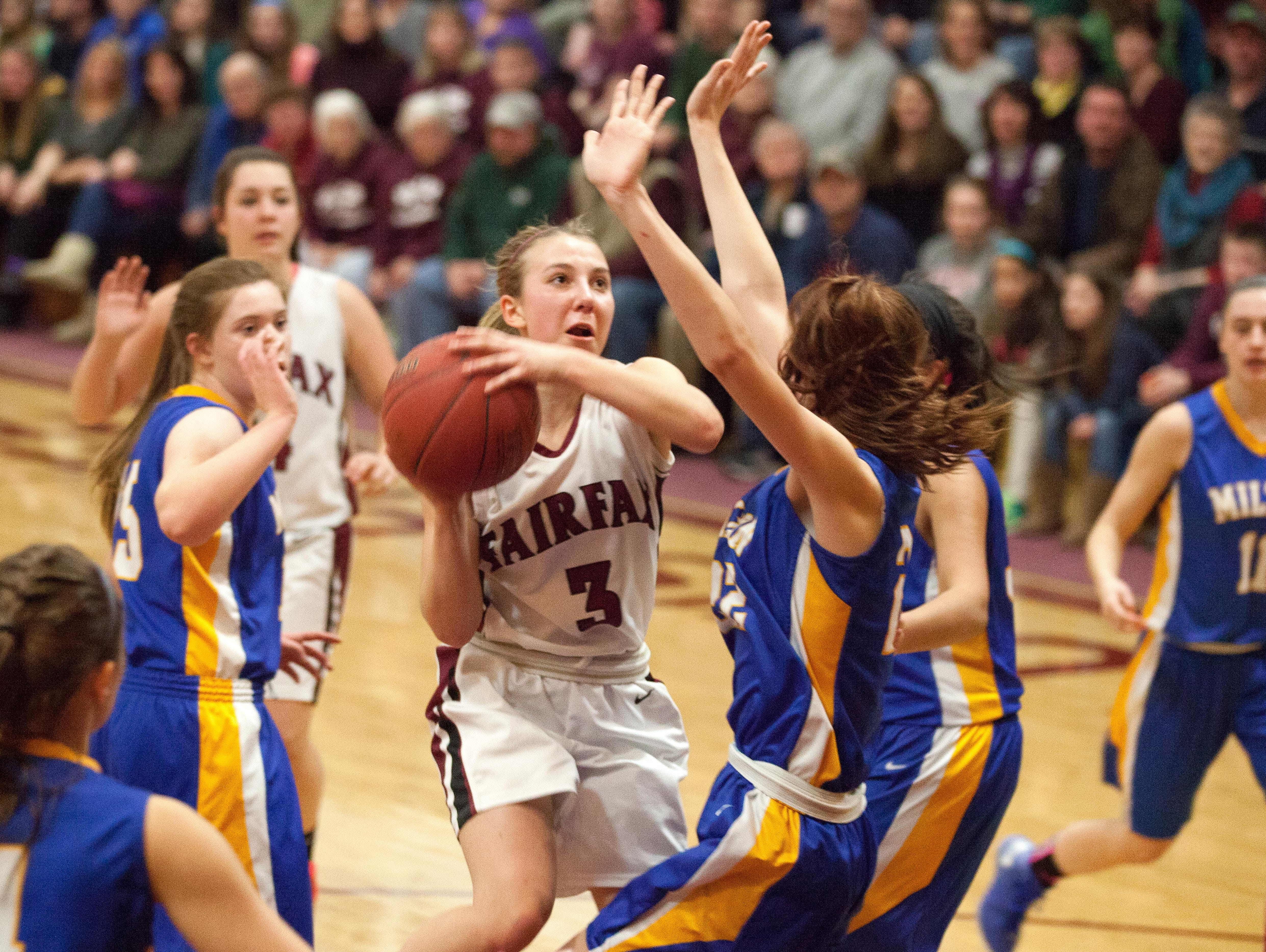 BFA Fairfax's Chace Carpenter works the lane in heavy traffic on her way to beating the school record in points scored for both boys and girls baseketball.
