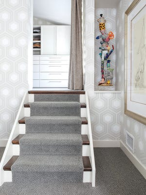 Continuity comes from repeating  colors, textures and shapes (such as the hex patterns seen in several rooms).