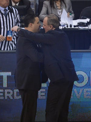 Arizona Wildcats head coach Sean Miller (left) congratulates Ohio State Buckeyes head coach Thad Matta (right) after the semifinals of the West regional of the 2013 NCAA tournament at the Staples Center. Ohio State defeated Arizona 73-70.