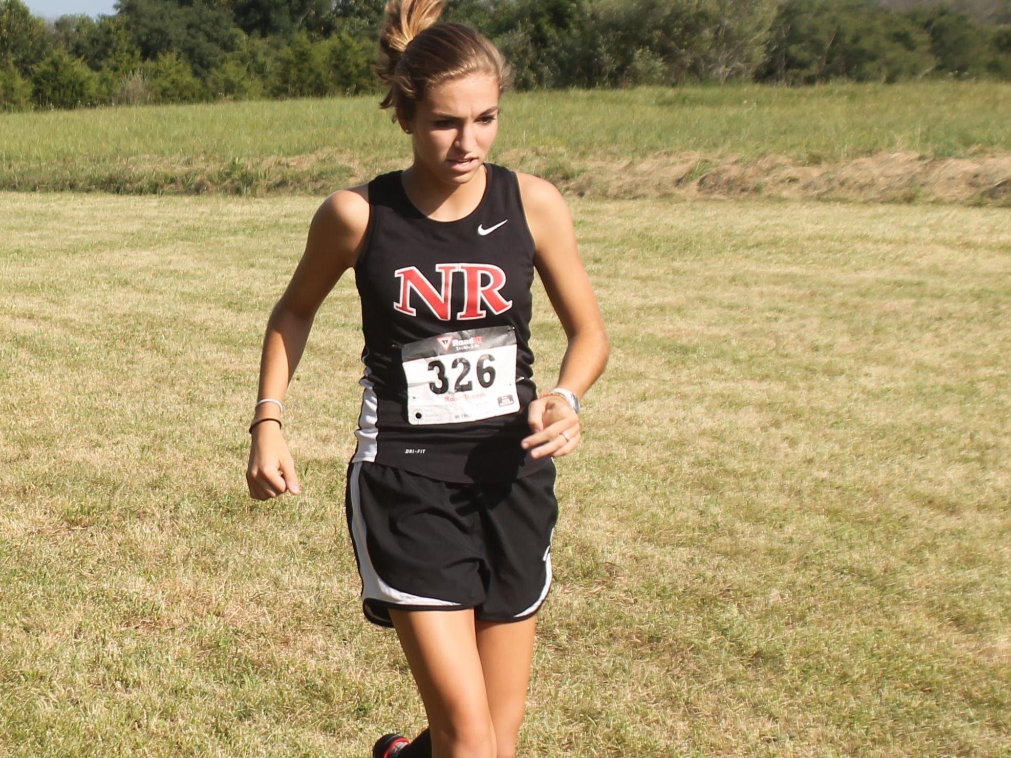 New Richmond junior Shelbi Simpson works on her pacing.