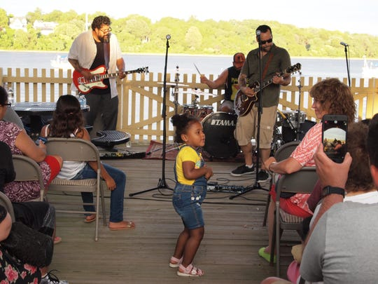 A youngster enjoys Perth Amboy Artworks' Live at the Ferry Slip concert series, which continues Aug. 5 with San Simon and GMJ Groove.