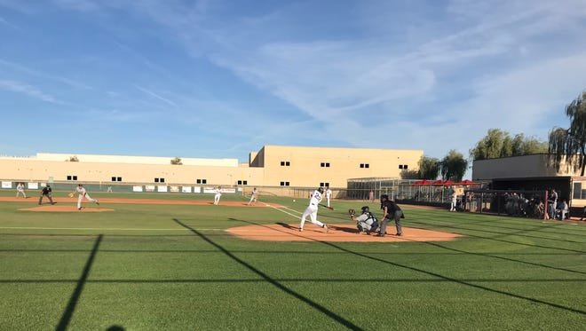 Chandler Hamilton's J.D. McLaughlin hits a double to take the lead in the bottom of the fifth against Phoenix Desert Vista.
