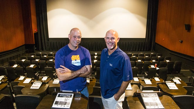 Operating partner Derek Dodd (left) and partner Craig Paschich stand in a theater at the Alamo Drafthouse Cinema at 4955 S. Arizona Ave. in Chandler on Feb. 14, 2017. Customers may order food and drink from their seats.