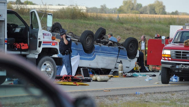 Emergency crews responded to a van crash on I-69 in Gibson County in southwestern Indiana on Thursday, Sept. 24, 2015. Sgt. Bruce Vanoven of the Gibson County Sheriff's Office said the 16-passenger van was carrying 24 people when a tire blew out, causing the vehicle to overturn.