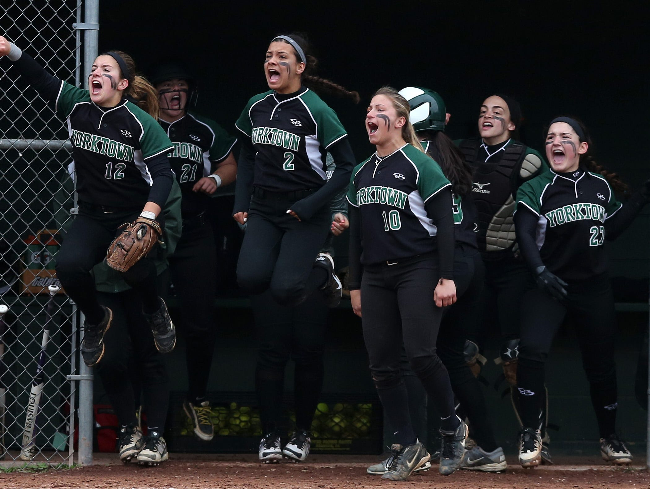 Yorktown players celebrate a run during a seventh inning rally against Brewster in a girls softball game at Brewster High School May 5, 2016. Yorktown won the game 6-4.