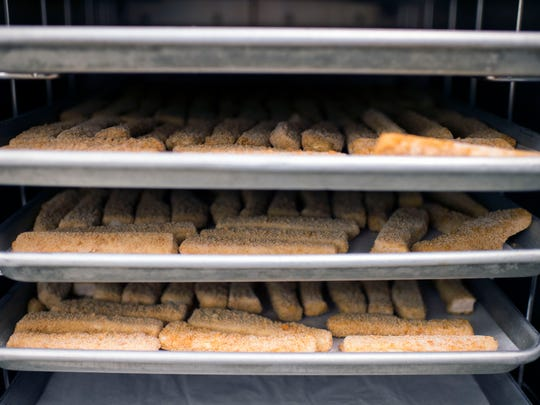 Trays of fish sticks for SoDel Concepts' taco entree offered at Indian River High School Thursday, March 26 in Dagsboro.