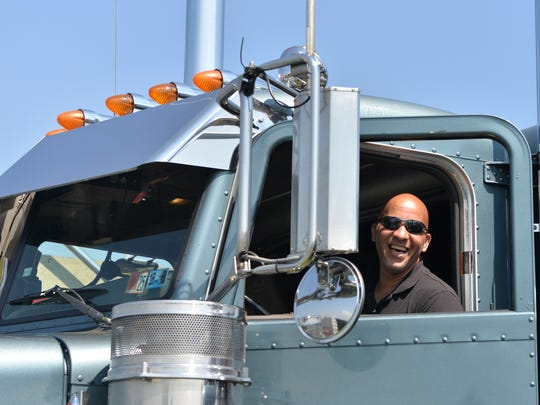 David Hughes of Souderton, Pa., smiles from the cab of his rig during the Transport for Christ Truck Rally held on Saturday, June 25, 2016, at the Lebanon Valley Expo Center in North Cornwall Township.