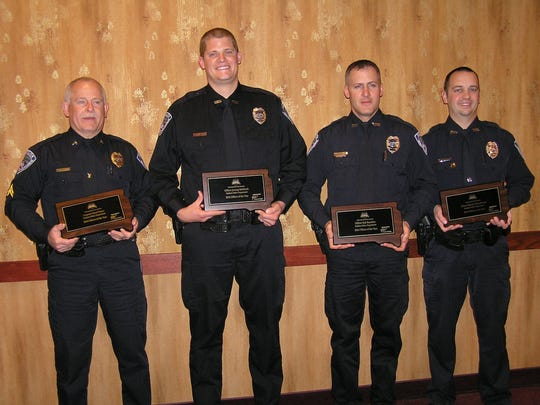 Yankton Police Officer Robert Buechler, second from