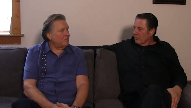 Mark James, left, talks to Bart Herbison about songwriting.
