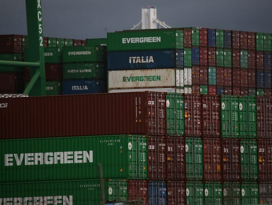 Stacks of shipping containers sit at the Port of Oakland