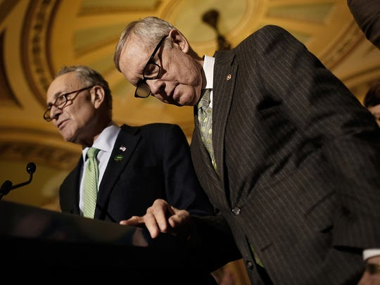 Sen. Charles Schumer, D-N.Y., answers questions with