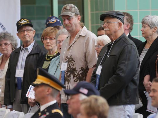 La Quinta veterans stand for a round of appreciation during the VeteranÕs Day Tribute and Recognition Ceremony at La Quinta City Hall, Wednesday, November 11, 201.5