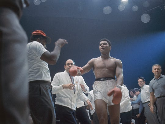 Muhammad Ali, or Cassius Clay, as he was known at the time, is shown during the heavyweight title fight against Sonny Liston in Miami Beach, Fla., Feb. 25, 1964. The bout lasted only one minute into the first round.