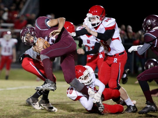 Stuarts Draft's Xzavier Gunn is tackled by Riverheads'