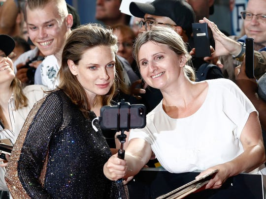 "Rebecca Ferguson greets fans at the premiere of ""Mission:"