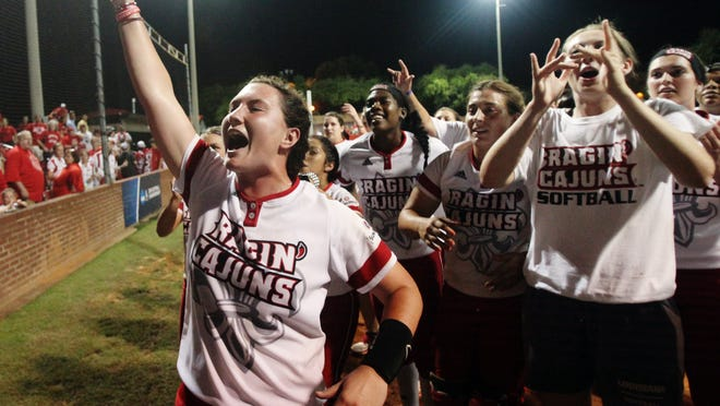 UL players cheer with fans after defeating Baylor 9-1 in the second of two games Sunday, May 17, 2015, during the NCAA Regional Softball Tournament at Lamson Park in Lafayette, La.