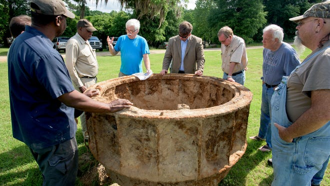 An old mill turbine, that was found in Autauga Creek, is examined in Prattville, Ala., on Tuesday May 10, 2016 after it was pulled out of the creek.