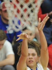 Cooper's Cheyenne Sherwood shoots a 3-point goal in