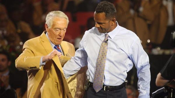 Former Buffalo Bills coach Marv Levy presents Andre Reed with his Hall of Fame jacket on Friday night.