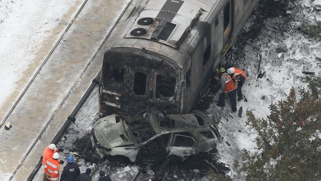 Aerial view of the Metro North train accident at the Commerce Street crossing in Valhalla .