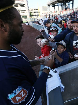 Fans gather to seek autographs from San Diego Padre Matt Kemp on Thursday.