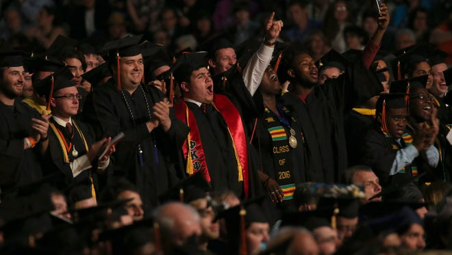 RIT grads celebrate during the RIT Academic Convocation.