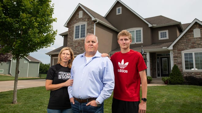Topeka City Councilman Tony Emerson, center, his wife, Allison Emerson, left, and their son, Andrew Emerson, right, all recovered last month from COVID-19.