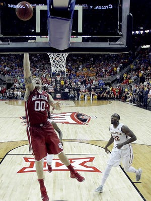 Oklahoma's Ryan Spangler (00) puts up and misses a last second shot during the second half of an NCAA college basketball game against Iowa State in the semifinals of the Big 12 Conference tournament Friday, March 13, 2015, in Kansas City, Mo. Iowa State won 67-65. (AP Photo/Charlie Riedel)