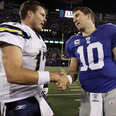 Traded for each other in 2004, could Philip Rivers, left, and Eli Manning both be on the move in 2016?